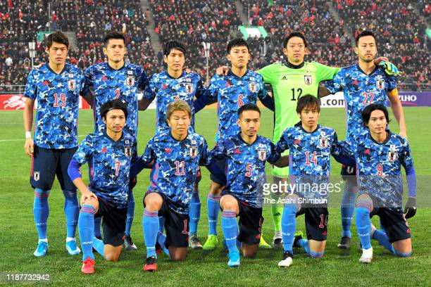 Japanese players line up for the team photo prior to the FIFA World Cup Asian Qualifier second round between Kyrgyz and Japan at Dolen Omurzakov...