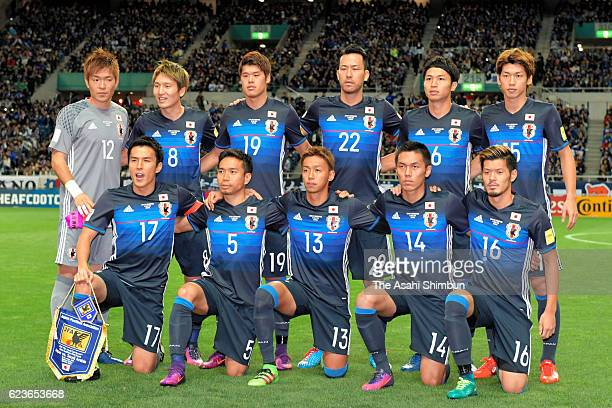 Japanese players line up for the team photos prior to the 2018 FIFA World Cup Qualifier match between Japan and Saudi Arabia at Saitama Stadium on...