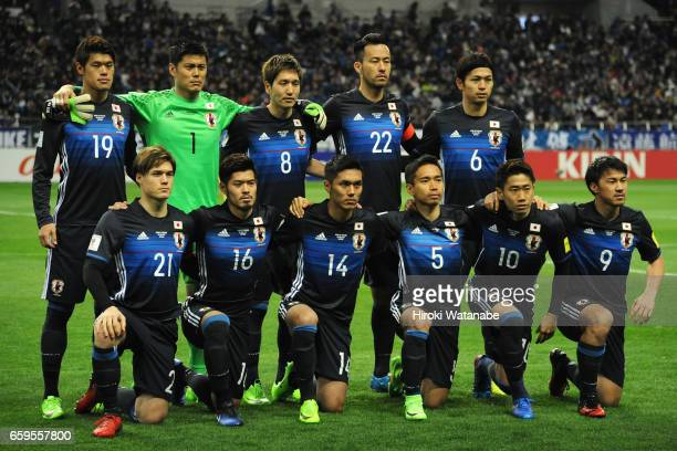 Japanese players line up for the team photos prior to the 2018 FIFA World Cup Qualifier match between Japan and Thailand at Saitama Stadium on March...