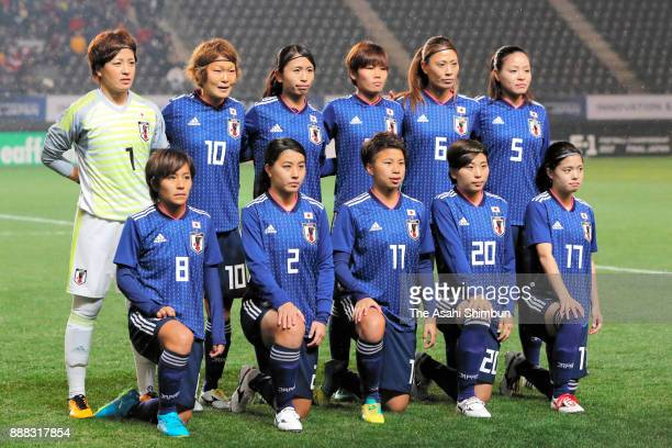 Japanese players line up for the team photos prior to the EAFF E1 Women's Football Championship between Japan and South Korea at Fukuda Denshi Arena...