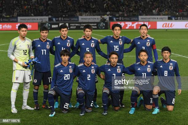 Japanese players line up for the team photos prior to the EAFF E1 Men's Football Championship between Japan and North Korea at Ajinomoto Stadium on...