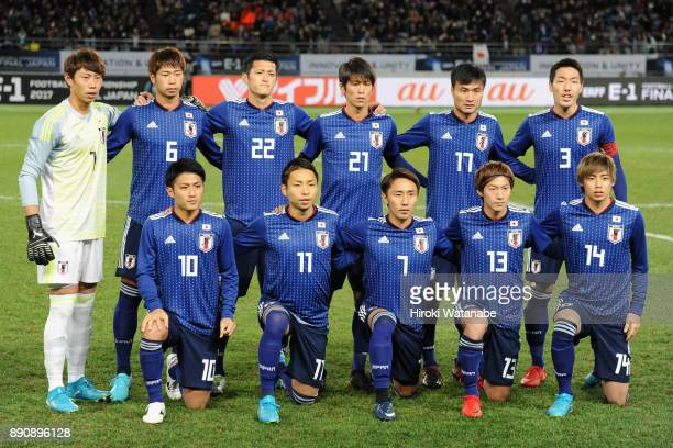Japanese players line up for the team photos prior to the EAFF E1 Men's Football Championship between Japan and China at Ajinomoto Stadium on...