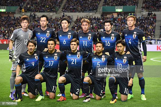 Japanese players line up for the team photos prior to the FIFA World Cup Russia Asian Qualifier second round match between Japan and Syria at the...