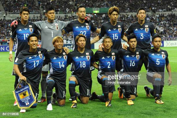 Japanese players line up for the team photos prior to the FIFA World Cup Qualifier match between Japan and Australia at Saitama Stadium on August 31...