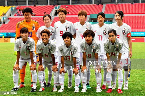 Japanese players line up for the team photos prior to the Football Women's semi final between South Korea and Japan at JSC Gelora Sriwijaya stadium...