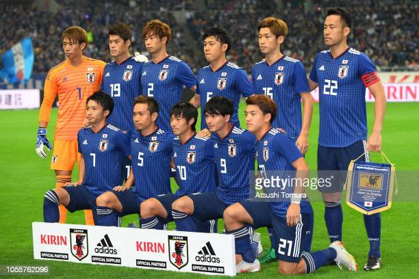 Japanese players line up for the team photos prior to the international friendly match between Japan and Uruguay at Saitama Stadium on October 16...