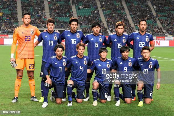 Japanese players line up for the team photos prior to the international friendly match between Japan and Venezuela at Oita Bank Dome on November 16...