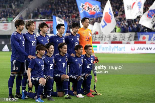 Japanese players line up for the team photos prior to the international friendly match between Japan and Bolivia at Noevir Stadium Kobe on March 26...