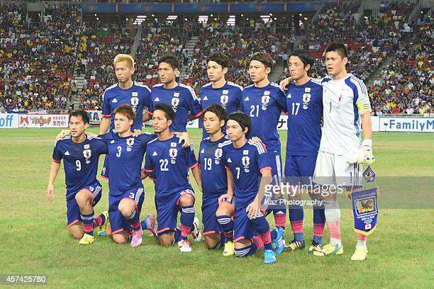 Japanese players line up for the team photos prior to the international friendly match between Japan and Brazil at the National Stadium on October 14...