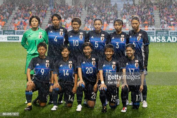 Japanese players line up for the team photos prior to the international friendly match between Japan and Switzerland at Nagano U Stadium on October...