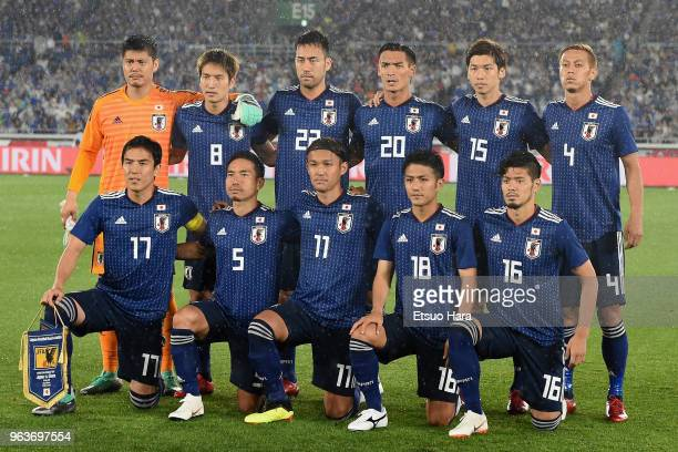 Japanese players line up for the team photos prior to the international friendly match between Japan and Ghana at Nissan Stadium on May 30 2018 in...