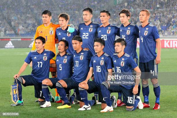 Japanese players line up for the team photos prior to the international friendly match between Japan and Ghana at Nissan Stadium on May 28 2018 in...