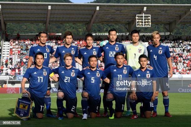 Japanese players line up for the team photos prior to the international friendly match between Switzerland and Japan at the Stadium Cornaredo on June...