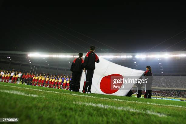 Japanese players listen to their national anthem on the field before the FIFA Women's World Cup 2007 Group A match between Germany and Japan at...