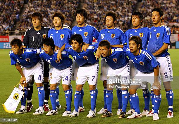 Japanese players pose for photographs prior to playing a soccer international friendly match between Japan under 23 and Argentina under 23 at the...