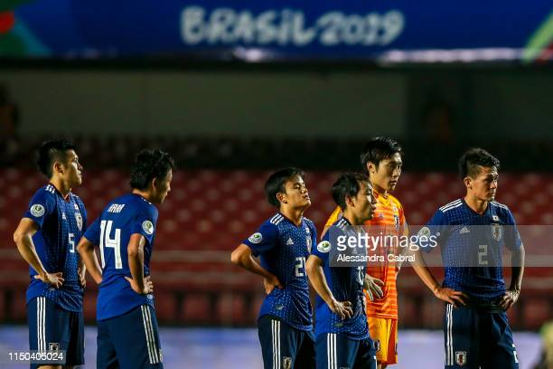 Japanese players react after losing the Copa America Brazil 2019 group C match between Japan and Chile at Morumbi Stadium on June 17, 2019 in Sao...