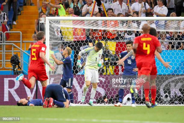 Japanese players show dejection after Belgium's third goal during the 2018 FIFA World Cup Russia Round of 16 match between Belgium and Japan at...