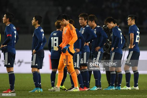 Japanese players show dejection after their 14 defeat in the EAFF E1 Men's Football Championship between Japan and South Korea at Ajinomoto Stadium...