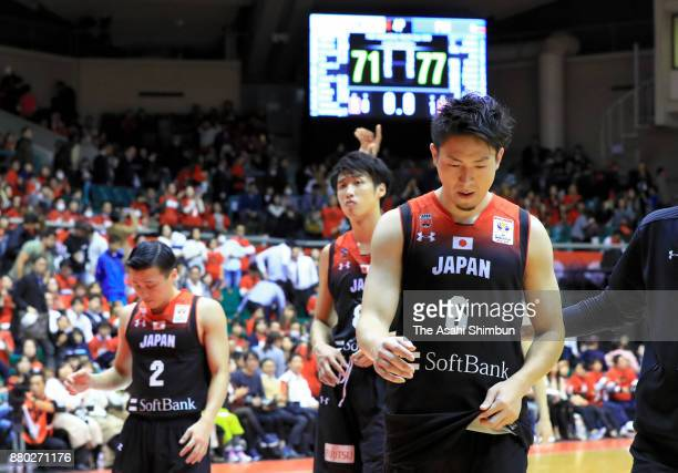 Japanese players show dejection after their 7177 defeat in the FIBA Basketball World Cup Asian Qualifier Group B match between Japan and Philippines...