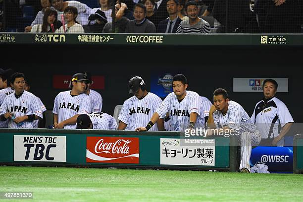 Japanese players show their dejection after the WBSC Premier 12 semi final match between South Korea and Japan at the Tokyo Dome on November 19 2015...
