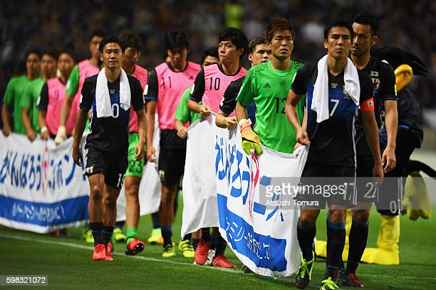 Japanese players show their dejection after their 12 defeat in the 2018 FIFA World Cup Qualifier Final Round Group B match between Japan and United...