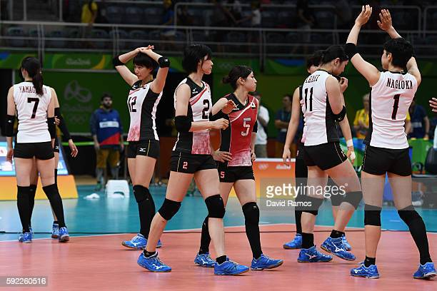 Japanese players show their dejection after their defeat in the Women's Quarterfinal match between Japan and The United States on day 11 of the Rio...