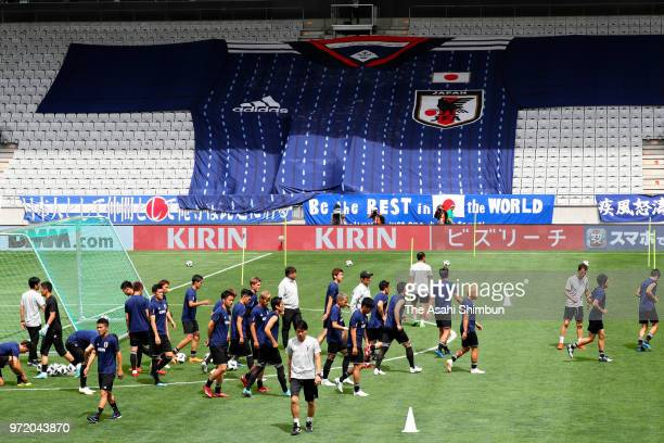 Japanese players warm up during a training session ahead of the international friendly match between Japan and Paraguay at Tivoli Stadion on June 11...