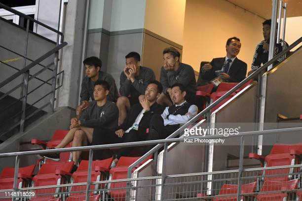 Japanese players who are not in the squad to plya such as Maya Yoshida Eiji Kawashima Shinji Okazaki and Tatefusa Kubo watching the game during the...