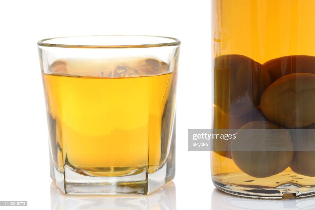 Japanese plum wine called umeshu, : Stock Photo