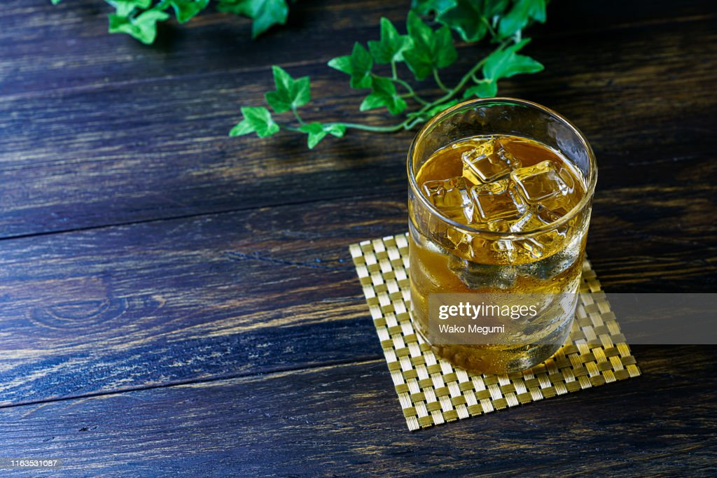 Japanese plum wine 'Umeshu' on wooden background : Stock Photo