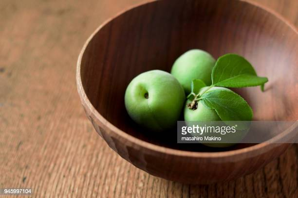 Japanese Plums In Wooden Bowl