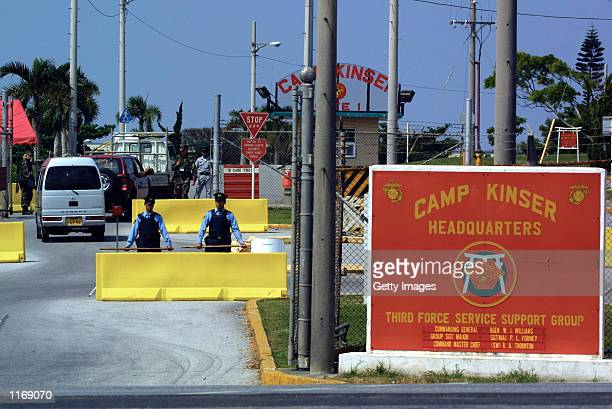 Japanese policeman stand guard at the Camp Kinse American military base October 12 2001 on the southern Japanese Island of Okinawa Security has...