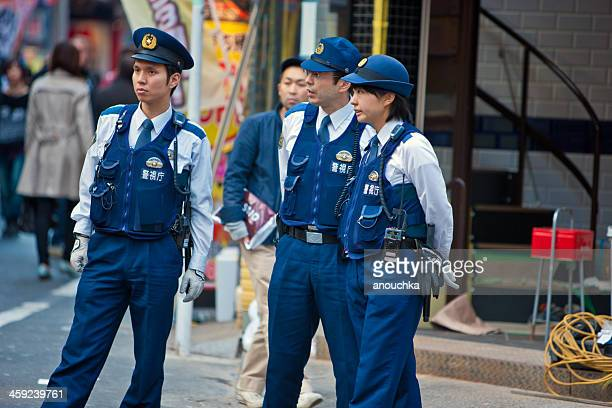 Japanese Policemen and Policewoman on Tokyo Street