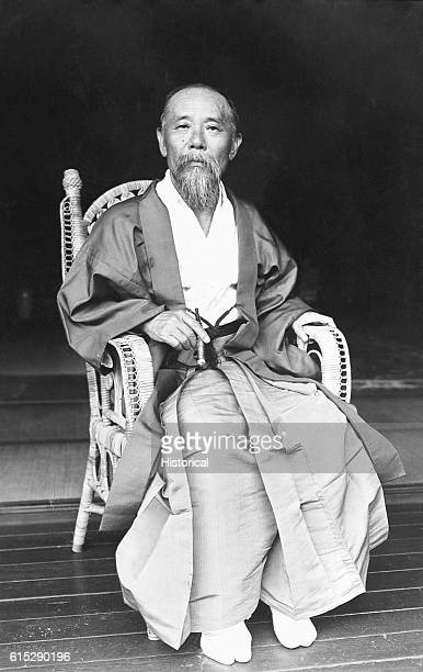 Japanese politician Ito Hirobumi sitting in a chair