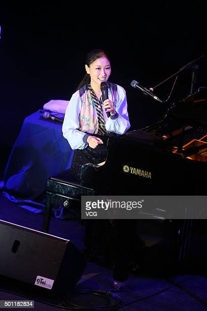 Japanese pop singer and songwriter Ai Otsuka performs onstage during her concert on December 12 2015 in Taipei Taiwan of China