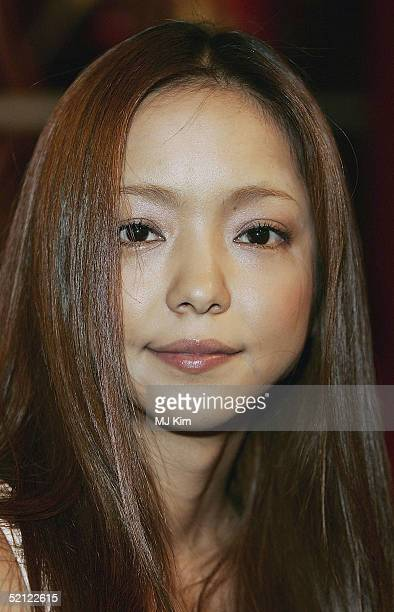 """Japanese pop singer Namie Amuro poses at a photo-call ahead of tomorrow's """"MTV Asia Aid"""", at the Met Bar of The Metroplitan Hotel on February 2, 2005..."""