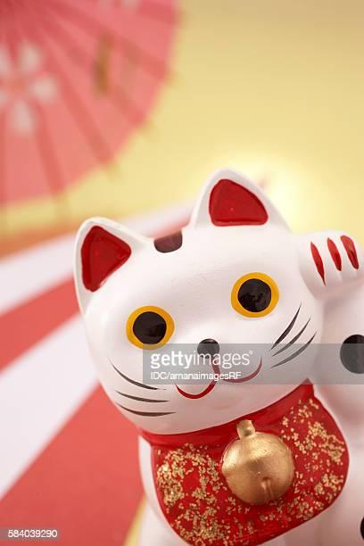 japanese porcelain cat - maneki neko stock photos and pictures
