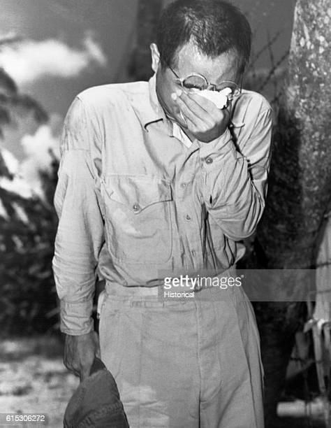 Japanese POW at Guam with bowed head after hearing Emperor Hirohito make announcement of Japan's unconditional surrender August 15 1945