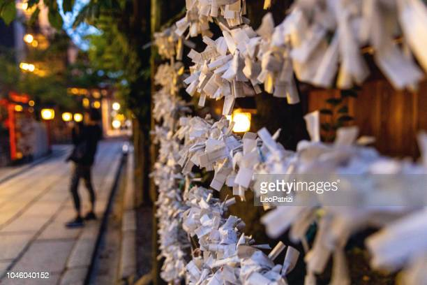 japanese prayer paper in temple - kiyomizu dera temple stock photos and pictures