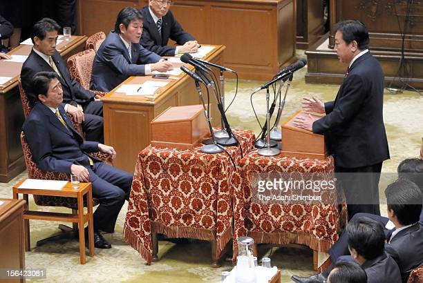 Japanese Prime Minister and ruling Democratic Party of Japan leader Yoshihiko Noda speaks while opposition Liberal Democratic Party leader Shinzo Abe...