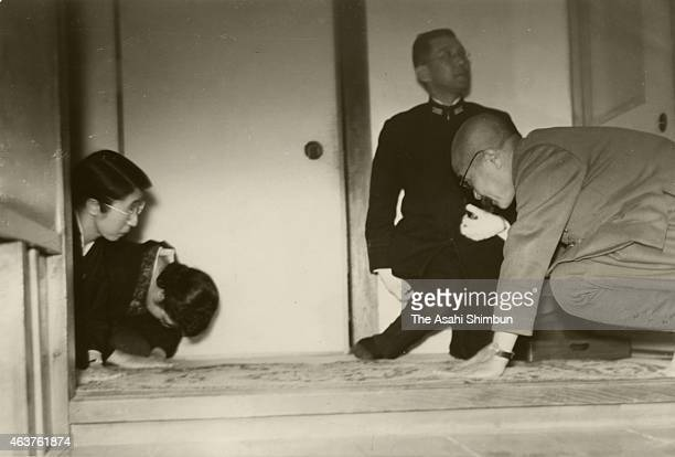 Japanese Prime Minister Hideki Tojo bows to family members of Imperial Navy Admiral Isoroku Yamamoto after Yamamoto's body return to Japan on May 21...