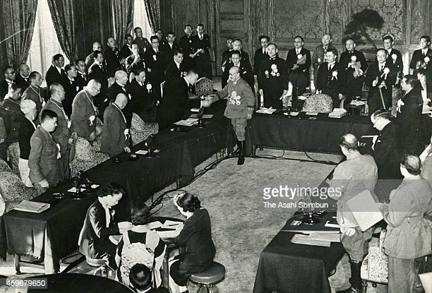 Japanese Prime Minister Hideki Tojo shakes hands with participants after the Greater East Asia Conference at the diet building on November 6 1943 in...