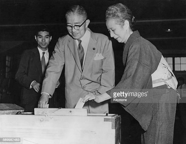 Japanese Prime Minister Ichiro Hatoyama and his wife Kaoru Hatoyama cast their votes at a polling station in Bunkyo Ward Tokyo during the election of...