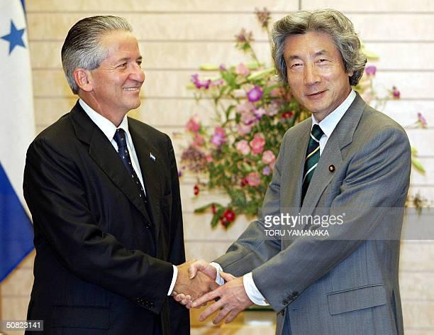 Japanese Prime Minister Jinichiro Koizumi welcomes Honduras President Ricardo Maduro prior to their talks at Koizumi's official residence in Tokyo 11...
