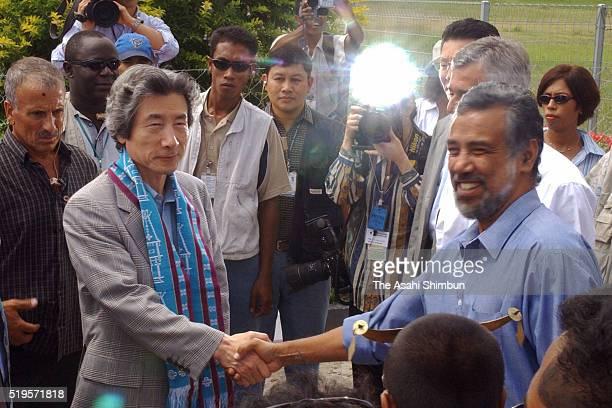 Japanese Prime Minister Junichiro Koizumi and East Timor independence leader and presidentelect Xanana Gusmao shake hands on Koizumi's arrival at...
