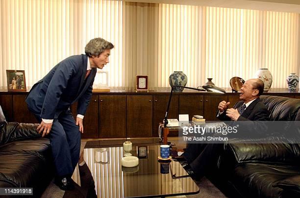 Japanese Prime Minister Junichiro Koizumi and former prime Minister Kiichi Miyazawa hold a meeting at Liberal Democratic Party headquarters on...