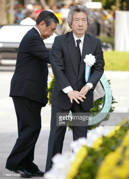 Japanese Prime Minister Junichiro Koizumi and Lower house Speaker Yohei Kono offer flower wreathes to the altar of the Atomic Bomb victims during the...