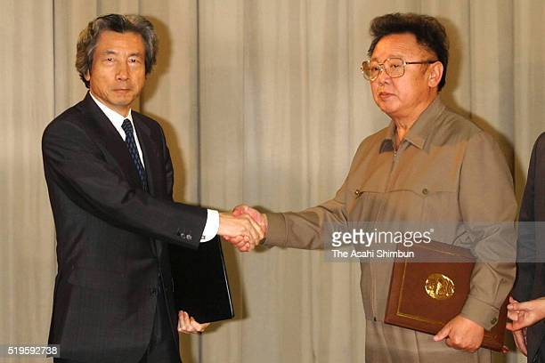 Japanese Prime Minister Junichiro Koizumi and North Korean leader Kim Jongil shake hands after signing the Pyongyang Declaration during their meeting...