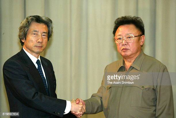 Japanese Prime Minister Junichiro Koizumi and North Korean leader Kim JongIl shake hands after signing the Pyongyang Declaration following their...