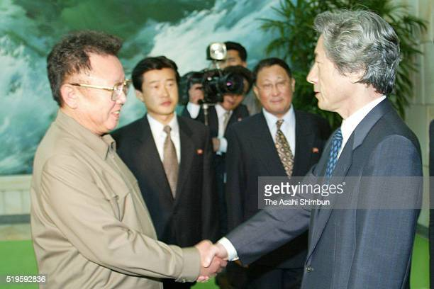 Japanese Prime Minister Junichiro Koizumi and North Korean leader Kim Jongil shake hands after their meeting at the Pakhuawon guest house on...